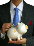 A gentleman deposits some money into the piggy bank poster