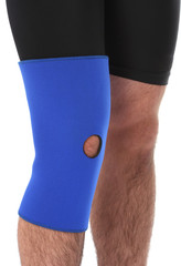 Man wearing a leg brace, over white