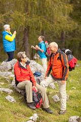 four hikers focus on couple in front