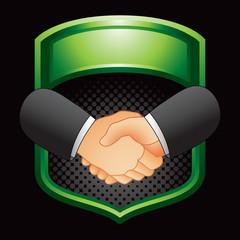 Business handshake in green display
