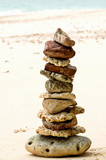stones on the beach - wellbeing poster