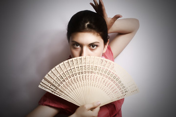 Portrait of the girl with a fan.