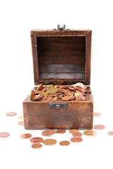 A wooden ancient chest full of money..