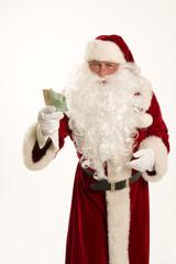 Weihnachten,Weihnachtsmann mit Geld in der Hand