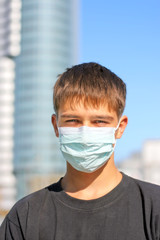 teenager in the flu mask on the street