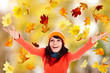 Girl  in autumn orange hat with outstretched arm. Outdoor.
