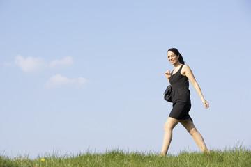 Woman Walking Through Summer Countryside