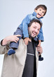 Happy father with boy on his sholders