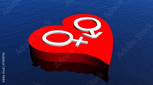 Heterosexual couple in red heart floating in the ocean