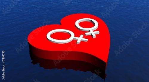 Lesbian couple in red heart floating in the ocean