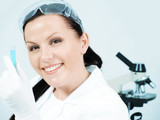 closeup of female researcher holding test tube in laboratory poster