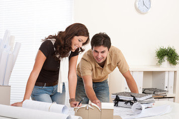 Young man and woman working at architect office