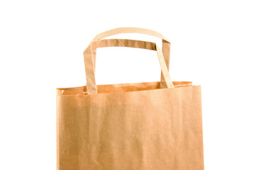 Empty paper shopping bag over white background