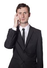 baffled businessman scratching his head