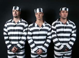 Three prisoners. Group of men in suits of convicts.