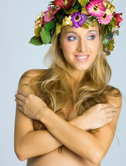 Close-up of woman with flower wreath