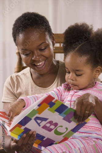 African mother reading to daughter