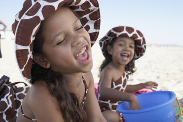 Young mixed race girls playing at beach
