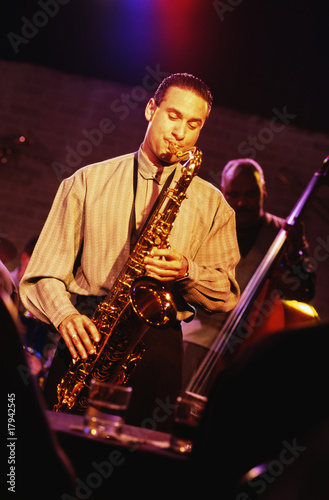 Man playing saxophone in nightclub