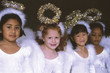 Girls in angel costumes smiling