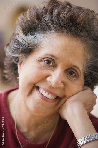 Close up of senior Hispanic woman smiling