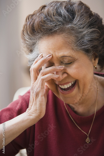 Close up of senior Hispanic woman laughing