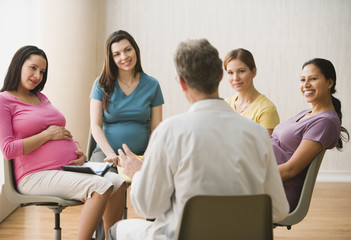 Group of pregnant women talking to doctor