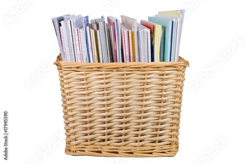 Wicker basket with textbooks and catalogs