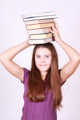 Teenager keeps much books on head