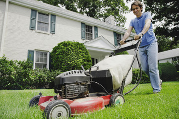 Man mowing front lawn