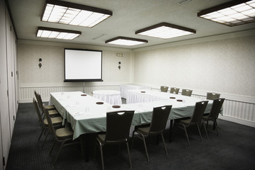 Empty conference room with projector screen