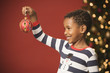 African boy holding Christmas ornament