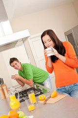 Young couple drinking coffe in the kitchen
