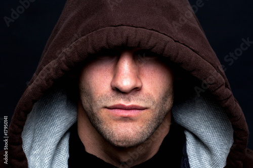 Evil looking hooded man