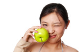 woman holding green apple and making a grimace poster