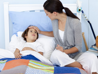 Mother taking her son's temperature