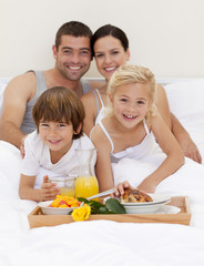 Family having breakfast in bedroom