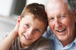 Closeup portrait of a happy senior man with grandson