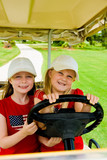 little sisters driving a golf cart poster