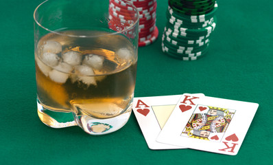 Counters of a card and a glass of whisky.