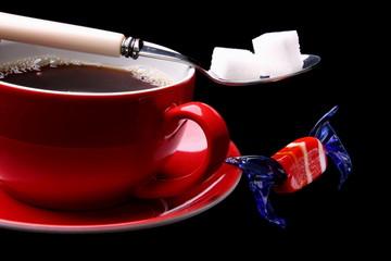 Kaffeetasse mit Kaffee und Zucker