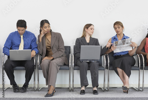 Multi-ethnic businesspeople in waiting room