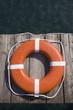 Round life preserver on wooden dock
