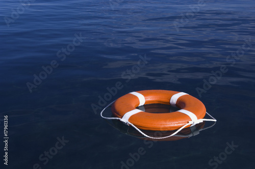Round life preserver floating in water