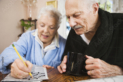 Senior couple doing crossword puzzle