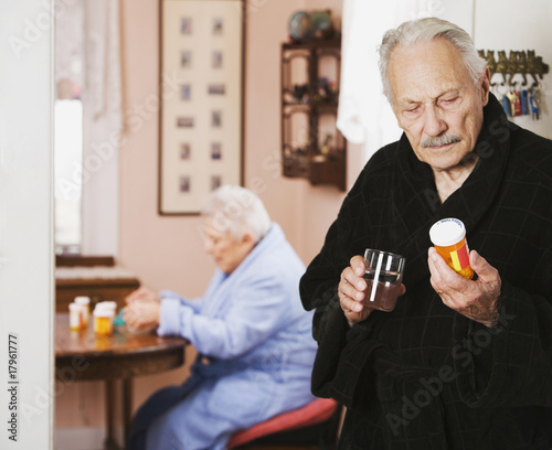 Senior couple taking medication