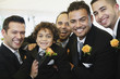 Multi-ethnic men and boy wearing tuxedos