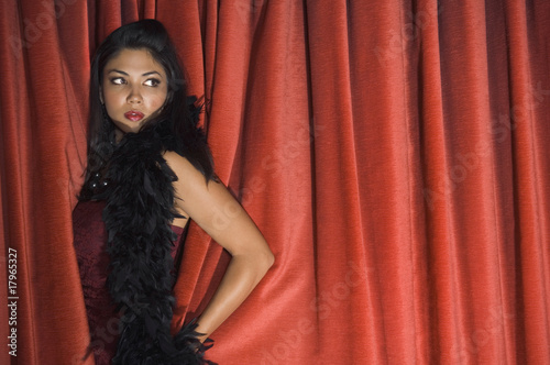 Asian woman standing in curtains