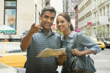 Hispanic couple using street map