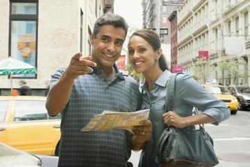 Hispanic couple using street map